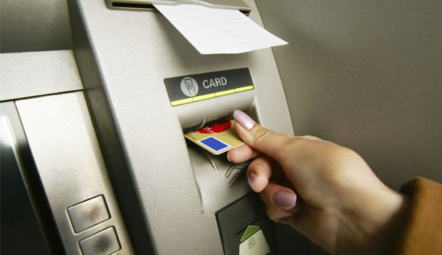 Cash card being put into a cash machine